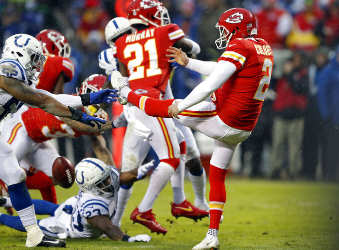Indianapolis Colts linebacker Najee Goode (52) blocks a punt by Kansas City Chiefs punter Dustin Colquitt (2) for a touchdown, during the first half of an NFL divisional football playoff game in Kansas City, Mo., Saturday, Jan. 12, 2019. (AP Photo/Charlie Neibergall)