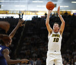 Iowa guard Joe Wieskamp (10) shoots a three-point basket against Illinois during the second half of an NCAA college basketball game, Sunday, Jan. 20, 2019, in Iowa City. (AP Photo/Matthew Putney)