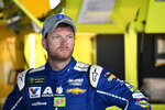 FILE - In this Saturday, June 3, 2017 file photo, Dale Earnhardt Jr. looks on in the garage during practice for the NASCAR Cup series auto race at Dover International Speedway in Dover, Del. NASCAR television analyst and former driver Dale Earnhardt Jr. was taken to a hospital after his plane crashed in east Tennessee. (AP Photo/Nick Wass, File)