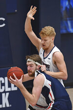 Saint Mary's Matthias Tass, back, guards Gonzaga's Drew Timme (2) during the first half of an NCAA college basketball game in Moraga, Calif., Saturday, Jan. 16, 2021. (Jose Carlos Fajardo/Bay Area News Group via AP)