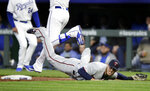Minnesota Twins first baseman C.J. Cron is pulled off the bag by an errant throw during the first inning of a baseball game against the Kansas City Royals at Kauffman Stadium in Kansas City, Mo., Tuesday, April 2, 2019. Royals designated hitter Jorge Soler was safe at first base on the play. (AP Photo/Orlin Wagner)