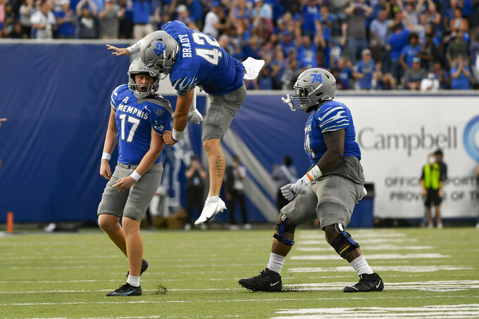 Memphis kicker Joe Doyle (17) celebrates with long snapper Preston Brady (42) and offensive lineman Isaac Ellis (74) after making a field goal in the final minutes of an NCAA college football game against Mississippi State, Saturday, Sept. 18, 2021, in Memphis, Tenn. (AP Photo/John Amis)