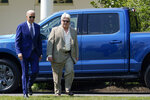 President Joe Biden walks with United Auto Workers Local 600 president Bernie Ricky before he speaks on the South Lawn of the White House in Washington, Thursday, Aug. 5, 2021, during an event on clean cars and trucks. (AP Photo/Susan Walsh)