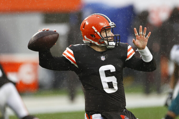 Cleveland Browns quarterback Baker Mayfield throws during the first half of an NFL football game against the Philadelphia Eagles, Sunday, Nov. 22, 2020, in Cleveland. (AP Photo/Ron Schwane)