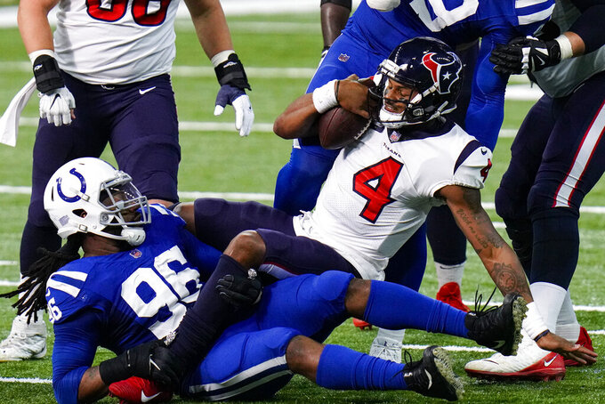 Houston Texans quarterback Deshaun Watson (4) is sacked by Indianapolis Colts defensive end Denico Autry (96) in the first half of an NFL football game in Indianapolis, Sunday, Dec. 20, 2020. (AP Photo/AJ Mast)