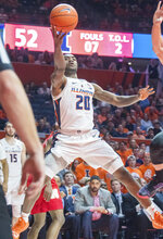 Illinois guard Da'Monte Williams (20) shoots during the second half of an NCAA college basketball game against Nebraska in Champaign, Ill., Saturday. Feb. 2, 2019. (AP Photo/Robin Scholz)
