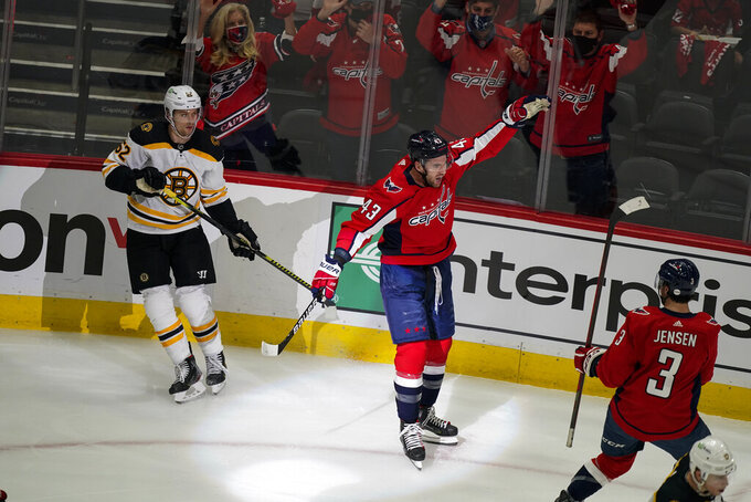 Washington Capitals right wing Tom Wilson (43) celebrates his goal during the first period of Game 1 of an NHL hockey Stanley Cup first-round playoff series against the Boston Bruins, Saturday, May 15, 2021, in Washington. (AP Photo/Alex Brandon)