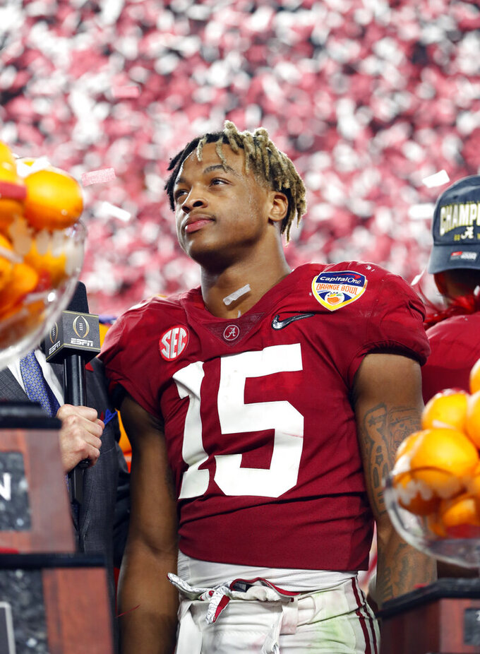 Alabama defensive back Xavier McKinney (15) stands next to the MVP trophy for the defensive player of the game during the Orange Bowl NCAA college football game, Sunday, Dec. 30, 2018, in Miami Gardens, Fla. Alabama defeated Oklahoma 45-34. (AP Photo/Wilfredo Lee)