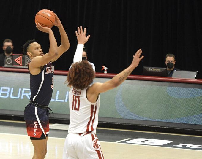Arizona guard Jemarl Baker Jr. (3) shoots over Washington State guard Isaac Bonton (10) in the first half of an NCAA college basketball game, Saturday, Jan. 2, 2021, in Pullman, Wash. (AP Photo/Dean Hare)