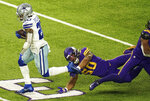 Dallas Cowboys running back Tony Pollard (20) rushes the ball past the tackle by Minnesota Vikings linebacker Eric Wilson (50) in the fourth quarter of an NFL football game in Minneapolis, Sunday, Nov. 22, 2020. (Anthony Souffle/Star Tribune via AP)