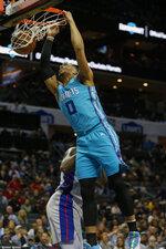 Charlotte Hornets forward Miles Bridges (0) dunks against the Detroit Pistons during the first half of an NBA basketball game in Charlotte, N.C., Friday, Nov. 15, 2019. (AP Photo/Nell Redmond)