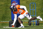 Denver Broncos outside linebacker Von Miller takes part in drills during an NFL football training camp at the team's headquarters Wednesday, Aug. 18, 2021, in Englewood, Colo. (AP Photo/David Zalubowski)