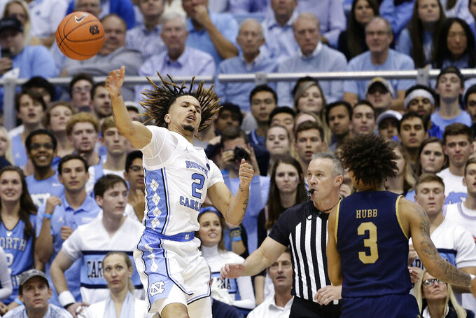 North Carolina guard Cole Anthony (2) saves the ball from out of bounds during the second half of an NCAA college basketball game against the Notre Dame in Chapel Hill, N.C., Wednesday, Nov. 6, 2019. North Carolina won 76-65. (AP Photo/Gerry Broome)