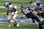Seattle Seahawks tight end Jacob Hollister (86) forces a fumble by Los Angeles Rams wide receiver Nsimba Webster (14) on a punt return during the second half of an NFL football game, Sunday, Dec. 27, 2020, in Seattle. The Rams recovered the ball. (AP Photo/Elaine Thompson)