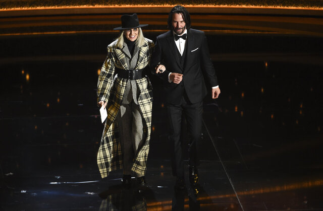 Diane Keaton, left, and Keanu Reeves appear on stage at the Oscars on Sunday, Feb. 9, 2020, at the Dolby Theatre in Los Angeles. (AP Photo/Chris Pizzello)