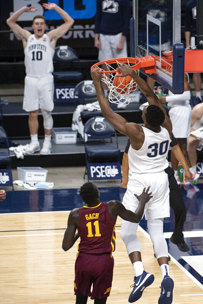 Penn State forward Abdou Tsimbila (30) dunks against Minnesota during an NCAA college basketball game Wednesday, March 3, 2021, in State College, Pa. (Noah Riffe/Centre Daily Times via AP)