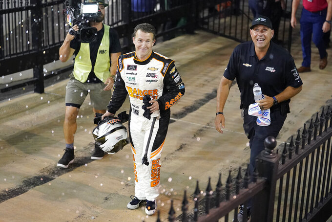 AJ Allmendinger walks to victory lane after crashing his car while crossing the finish line to win a NASCAR Xfinity Series auto race at Bristol Motor Speedway Friday, Sept. 17, 2021, in Bristol, Tenn. (AP Photo/Mark Humphrey)