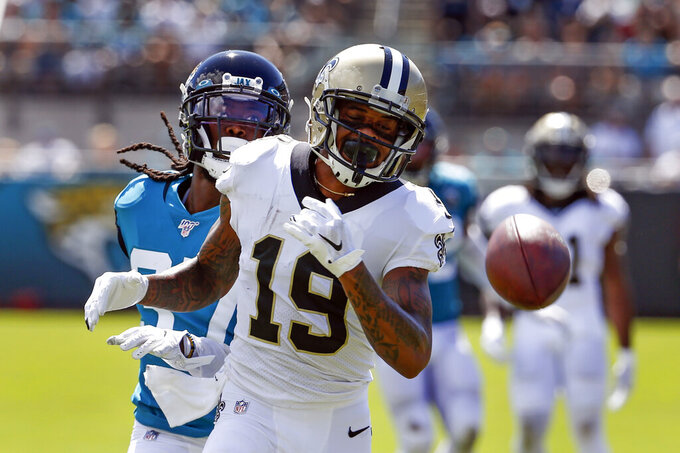 New Orleans Saints wide receiver Ted Ginn (19) cannot makes a reception on a pass as he is covered by Jacksonville Jaguars cornerback Tre Herndon, left, during the first half of an NFL football game, Sunday, Oct. 13, 2019, in Jacksonville, Fla. (AP Photo/Stephen B. Morton)