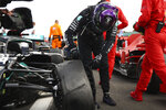 Mercedes driver Lewis Hamilton of Britain inspects puncture on his car after winning the British Formula One Grand Prix at the Silverstone racetrack, Silverstone, England, Sunday, Aug. 2, 2020. (Bryn Lennon/Pool via AP)