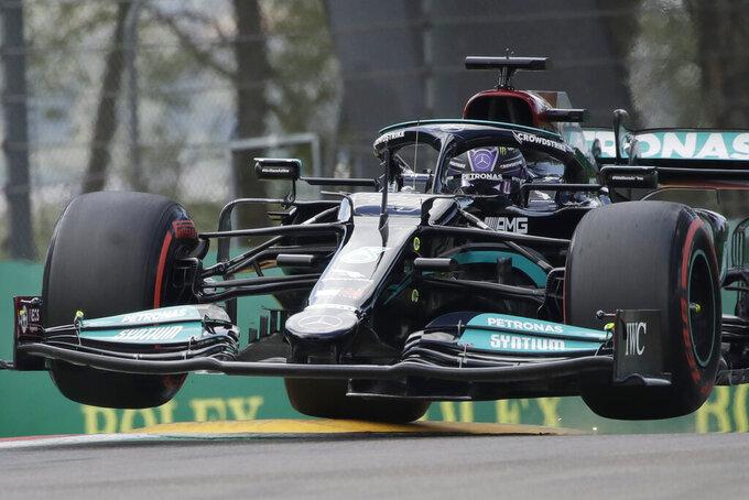 Mercedes driver Lewis Hamilton of Britain steers his car during qualifying practice for Sunday's Emilia Romagna Formula One Grand Prix, at the Imola track, Italy, Saturday, April 17, 2021. (AP Photo/Luca Bruno)