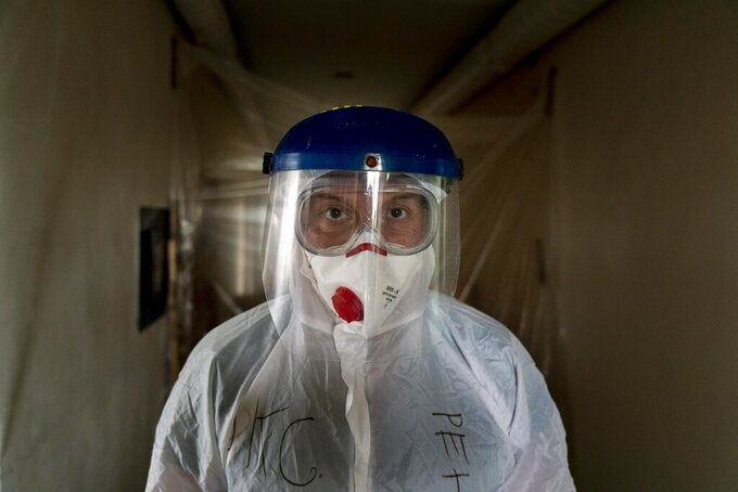 Dr. Oleh Hornostayev walks through a corridor at the hospital in Stryi, Ukraine, on Tuesday, Sept. 29, 2020. Coronavirus infections in Ukraine began surging in late summer, and the ripples are hitting towns in the western part of the country. The government wants to avoid imposing a new lockdown, but officials acknowledge that the rising infections could make it necessary. (AP Photo/Evgeniy Maloletka)