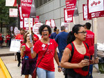 Nurses at the University of Chicago Medical Center, represented by National Nurses United, strike outside the South Side hospital, Friday, Sept. 20, 2019 in Chicago. Nurses are holding a one-day strike following what they call a breakdown of contract negotiations between their union and the hospital.   (Ashlee Rezin Garcia /Chicago Sun-Times via AP)