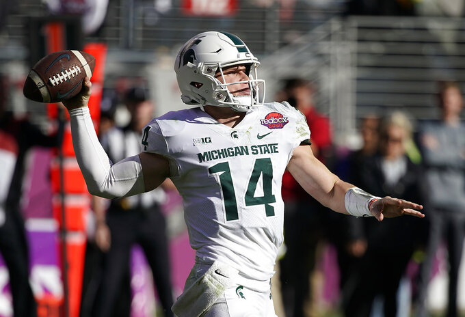 Michigan State quarterback Brian Lewerke (14) throws a pass against Oregon during the first half of the Redbox Bowl NCAA college football game Monday, Dec. 31, 2018, in Santa Clara, Calif. (AP Photo/Tony Avelar)