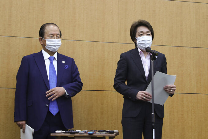 Seiko Hashimoto, right, president of the Tokyo Organizing Committee of the Olympic and Paralympic Games (Tokyo 2020), speaks as Toshiro Muto, CEO of Tokyo 2020, stands by her after a five-party meeting at the Tokyo 2020 headquarters in Tokyo on Wednesday, March 3, 2021. (Du Xiaoyi/Pool Photo via AP)