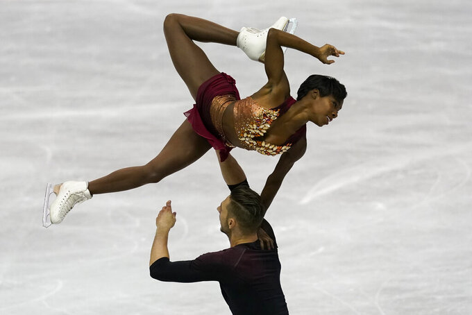 FILE - France's Vanessa James and Morgan Cipresperform their pairs short program during the ISU World Team Trophy Figure Skating competition in Fukuoka, southwestern Japan, in this Friday, April 12, 2019, file photo. Two-time Olympian Vanessa James of France will be performing at Figure Skating in Harlem's 2021 Champions in Life Virtual Gala on Thursday, April 22, 2021. (AP Photo/Toru Hanai, File)