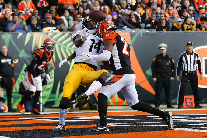 Pittsburgh Steelers wide receiver Tevin Jones (14) misses a pass against Cincinnati Bengals defensive back Darqueze Dennard, right, during the first half an NFL football game, Sunday, Nov. 24, 2019, in Cincinnati. (AP Photo/Frank Victores)