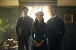 This image released by Netflix shows Henry Cavill, from left, Millie Bobby Brown and Sam Claflin in a scene from
