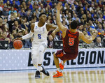 Virginia Tech guard Justin Robinson (5) falls backward after being fouled by Duke forward RJ Barrett (5) during the first half of an NCAA men's college basketball tournament East Region semifinal in Washington, Friday, March 29, 2019. (AP Photo/Patrick Semansky)