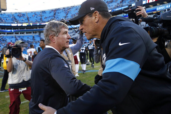 Washington Redskins head coach Bill Callahan and Carolina Panthers head coach Ron Rivera speak following an NFL football game in Charlotte, N.C., Sunday, Dec. 1, 2019. (AP Photo/Brian Blanco)