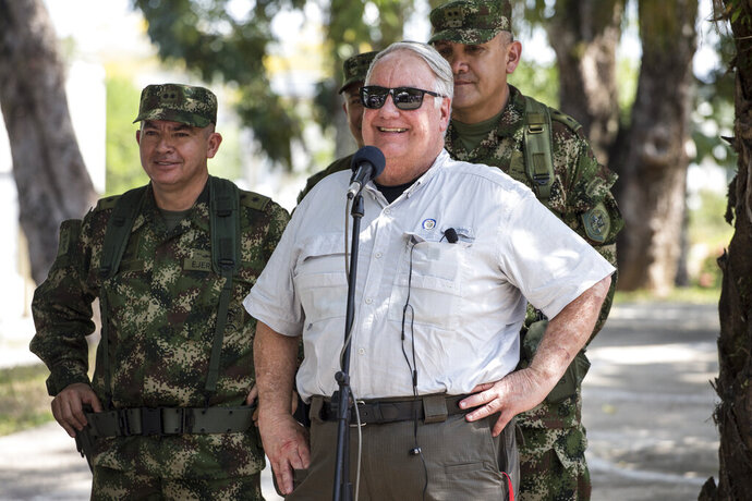 In this Jan. 29, 2020 photo, Howard Buffett smiles during a joint press conference with Colombia's President Ivan Duque at the military base in Tibu, Colombia. For nearly two decades Buffett has crisscrossed the world giving away part of his father's fortune to promote food security, conflict mitigation and public safety. But his latest gamble is one of the most daunting yet: helping Colombia kick its cocaine curse.  (AP Photo/Ivan Valencia)
