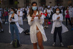 Medical residents, who removed their clothes to protest against working conditions, take part on a protest during a strike in Barcelona, Spain, Tuesday, Oct. 20, 2020. Regional authorities across Spain continue to tighten restrictions against a sharp resurgence of coronavirus infections that is bringing the country's cumulative caseload close to one million infections, the highest tally in western Europe. (AP Photo/Emilio Morenatti)