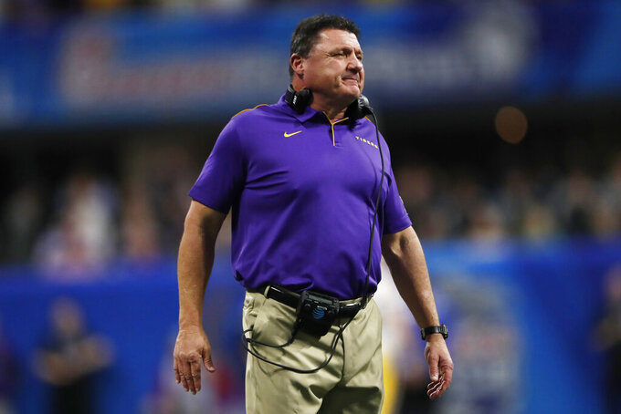 LSU coach Ed Orgeron waits for players during the first half of the Peach Bowl NCAA semifinal college football playoff game against Oklahoma, Saturday, Dec. 28, 2019, in Atlanta. (AP Photo/John Bazemore)