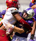 Iowa State defensive end JaQuan Bailey (3) forces TCU quarterback Matthew Downing (17) to fumble the ball during an NCAA college football game on Saturday, Sept. 26, 2020 in Fort Worth, Texas. Iowa would recover the ball on the play. (AP Photo/Brandon Wade)