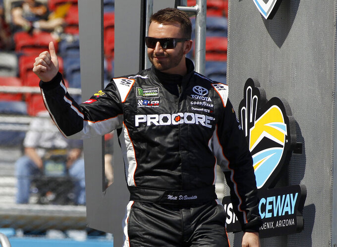 Matt DiBenedetto waves to the crowd during driver introductions prior to the start of the NASCAR Cup Series auto race at ISM Raceway, Sunday, March 10, 2019, in Avondale, Ariz. (AP Photo/Ralph Freso)