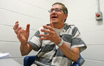 """In this Tuesday, May 1, 2018 photo, inmate Richard Walls gestures during an interview at the Richmond City Jail in Richmond, Va. Walls is not a hardened criminal, but he is what Virginia calls a """"habitual drunkard,"""" a designation that allows police to arrest him and jail him for up to a year if he's caught with alcohol. (AP Photo/Steve Helber)"""