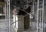 A meteorite on exhibit at the entrance of Brazil's National Museum stills stands at its original place after a fire destroyed the building in 2018, in Rio de Janeiro, Brazil, Tuesday, Feb. 12, 2019. Brazil's National Museum stands, gutted by fire, in Rio de Janeiro, Brazil, Tuesday, Feb. 12, 2019. Five months after a devastating fire engulfed Brazil's National Museum, the facility is still in dire straits and efforts to rebuild slow-moving. (AP Photo/Silvia Izquierdo)