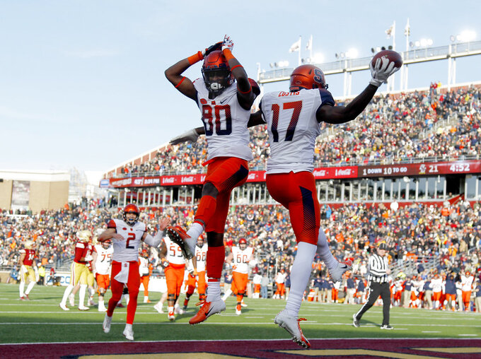 Syracuse wide receiver Jamal Custis (17) celebrates with teammate Taj Harris (80) after scoring a touchdown during the second half of an NCAA college football game against Boston College, Saturday, Nov. 24, 2018, in Boston. (AP Photo/Mary Schwalm)