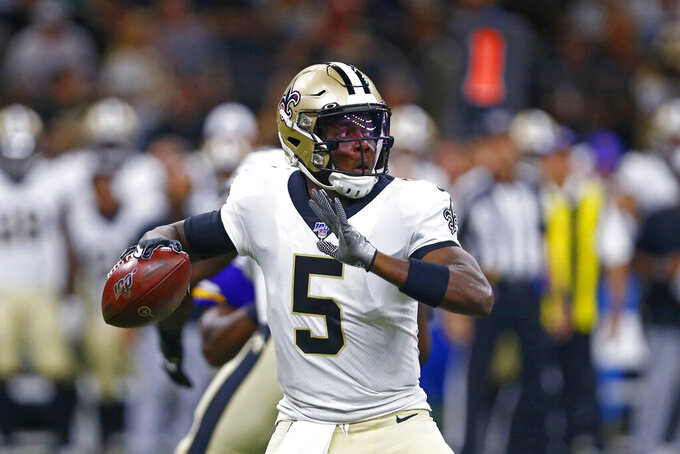 New Orleans Saints quarterback Teddy Bridgewater (5) passes in the first half of an NFL preseason football game against the Minnesota Vikings in New Orleans, Friday, Aug. 9, 2019. (AP Photo/Butch Dill)