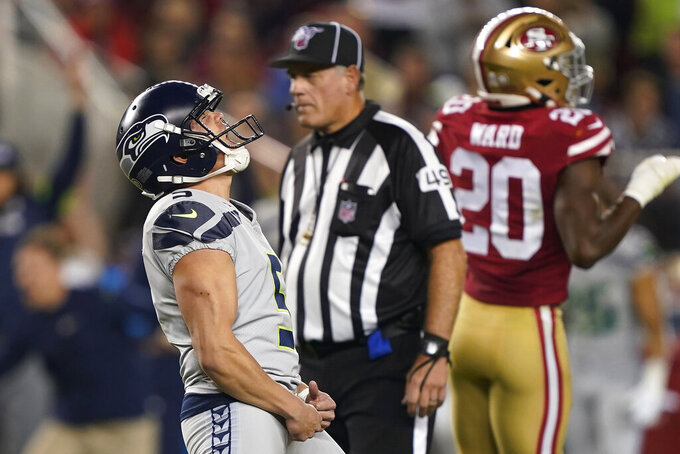 Seattle Seahawks kicker Jason Myers, left, celebrates after kicking the winning field goal during overtime of an NFL football game against the San Francisco 49ers in Santa Clara, Calif., Monday, Nov. 11, 2019. Seattle won 27-24. (AP Photo/Tony Avelar)