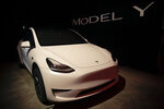 FILE- In this March 14, 2019, file photo Tesla's Model Y is displayed at Tesla's design studio in Hawthorne, Calif. Tesla CEO Elon Musk says the electric car pioneer plans to build a new factory near Berlin. News agency dpa reported that Musk made the announcement during a prizegiving ceremony in the German capital Tuesday evening. (AP Photo/Jae C. Hong, File)