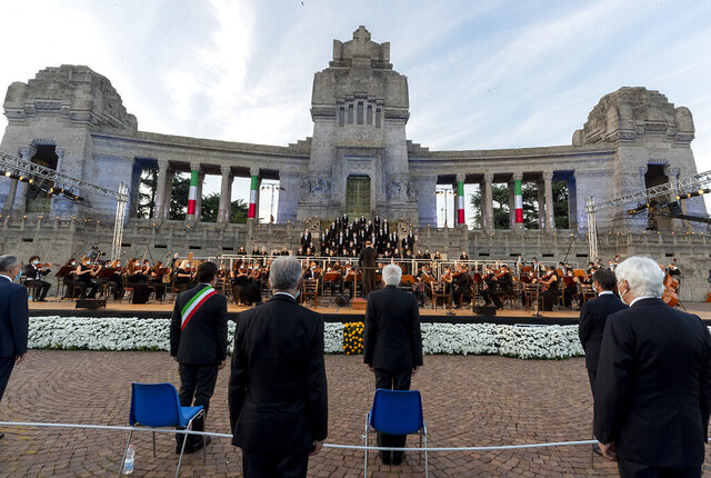 "Italian President Sergio Mattarella, center, speaks in front of Bergamo's cemetery, Sunday, June 28, 2020. Italy bid farewell to its coronavirus dead on Sunday with a haunting Requiem concert performed at the entrance to the cemetery of Bergamo, the hardest-hit province in the onetime epicenter of the outbreak in Europe. President Sergio Mattarella was the guest of honor, and said his presence made clear that all of Italy was bowing down to honor Bergamo's dead, ""the thousands of men and women killed by a sickness that is still greatly unknown and continues to threaten the world."" (Italian Presidency via AP)"