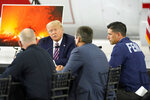President Donald Trump speaks during a briefing at Sacramento McClellan Airport, in McClellan Park, Calif., Monday, Sept. 14, 2020, on the western wildfires. At right is acting Homeland Security Secretary Chad Wolf. (AP Photo/Andrew Harnik)