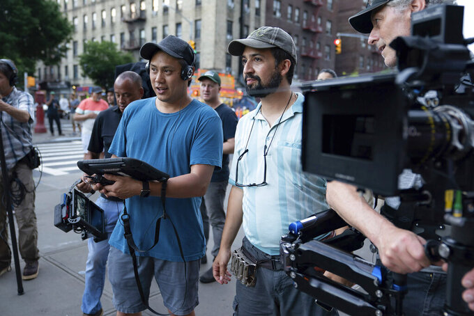 """This image released by Warner Bros. Picures shows director Jon M. Chu, left, and Lin-Manuel Miranda on the set of """"In the Heights,"""" which will open the Tribeca Film Festival in June. (Macall Polay/Warner Bros. Entertainment via AP)"""