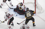 Chicago Blackhawks goalie Corey Crawford (50) makes the save on Vegas Golden Knights' Paul Stastny (26) during the second period in Game 1 of an NHL hockey Stanley Cup first-round playoff series, Tuesday, Aug. 11, 2020, in Edmonton, Alberta. (Jason Franson/The Canadian Press via AP)