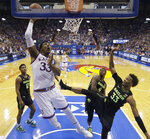 Kansas' David McCormack (33) gets past Baylor's Freddie Gillespie (33) to dunk the ball during the first half of an NCAA college basketball game Saturday, March 9, 2019, in Lawrence, Kan. (AP Photo/Charlie Riedel)