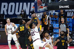 Gonzaga forward Anton Watson (22) drives on Norfolk State forward Chris Ford (32) during the first half of a men's college basketball game in the first round of the NCAA tournament at Bankers Life Fieldhouse in Indianapolis, Saturday, March 20, 2021. (AP Photo/Paul Sancya)
